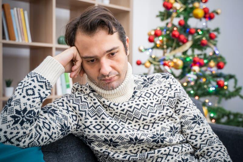 Sad man portrait feeling negative emotions during christmas royalty free stock photography