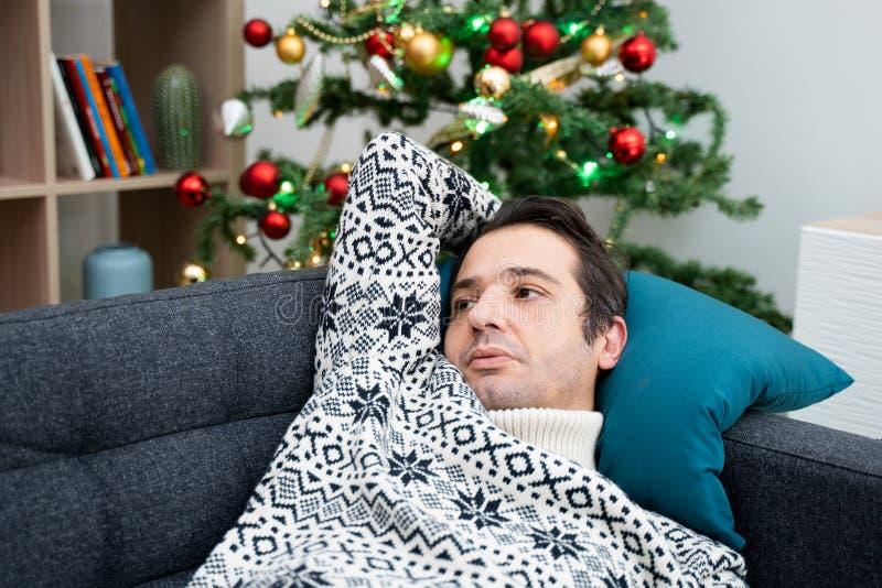 Sad man portrait feeling negative emotions during christmas stock image