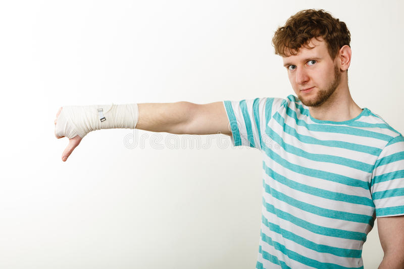 Sad Man Showing Thumb Down By Bandaged Hand Stock Image Image Of