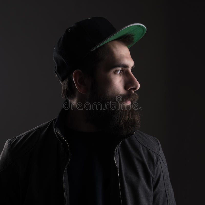 Sad man wearing baseball cap looking away royalty free stock photos