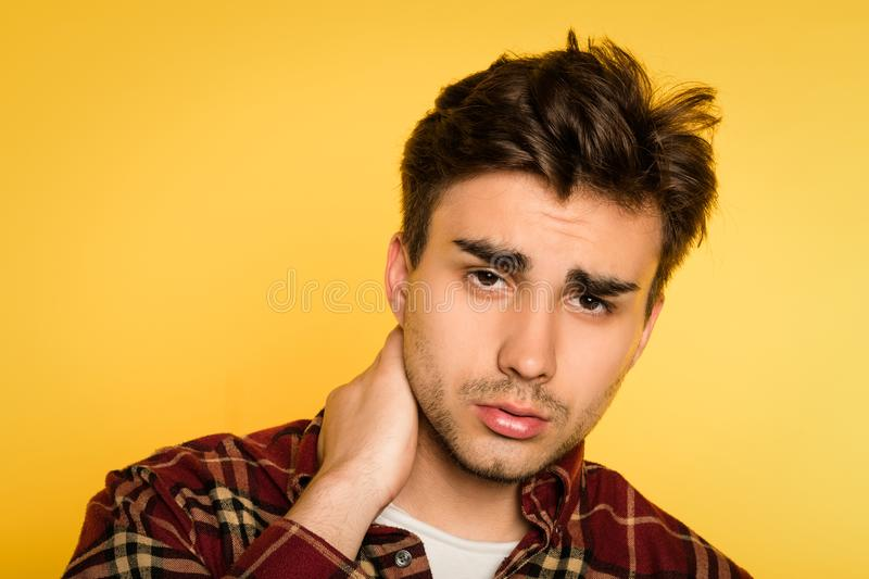 Sad man worried troubled look regret emotion. Sad man with worried alarmed troubled look. feeling regret and remorse. portrait of a young handsome brunet guy on royalty free stock photography