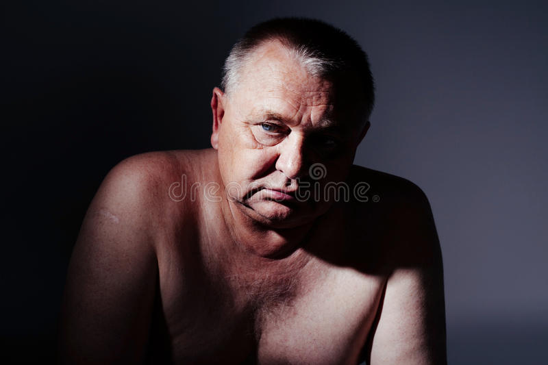 Sad mature man stock images