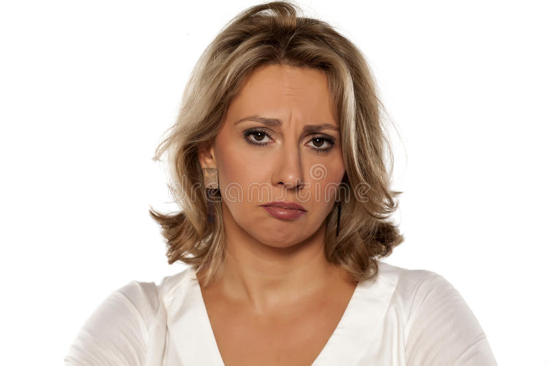 Sad middle-aged woman. Sad beautiful middle-aged woman on a white background royalty free stock photography