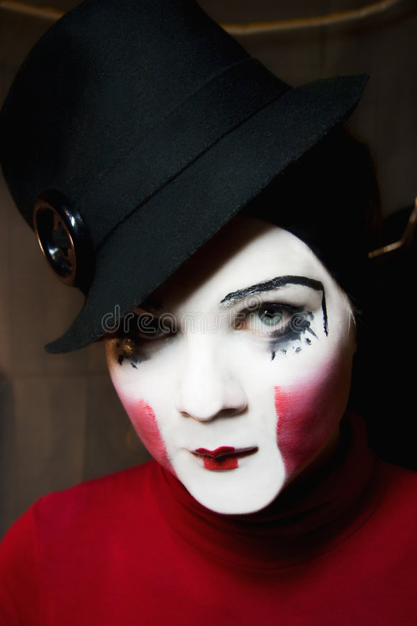 Sad mime in a hat stock photography