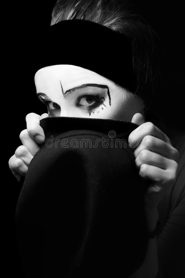 Sad mime with a hat. Portrait of the sad mime with a hat royalty free stock photos