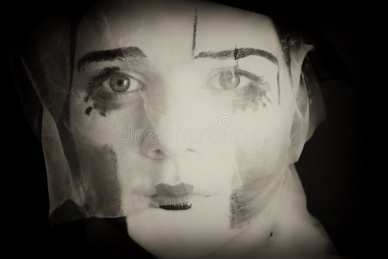 Sad mime in a veil. Portrait of the sad mime in a veil stock image