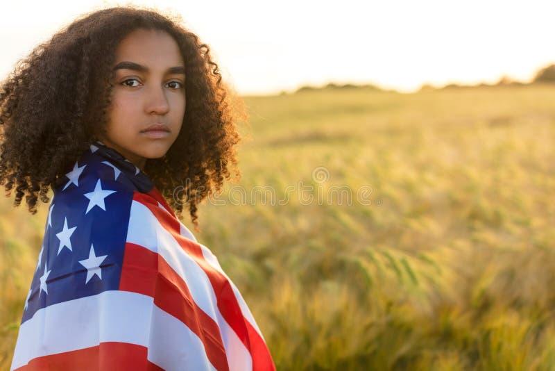 Sad Mixed Race African American Girl Teenager USA Flag Sunset royalty free stock image