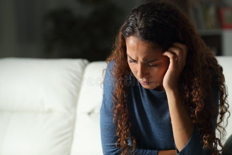 Sad mixed race woman complaining at home stock images