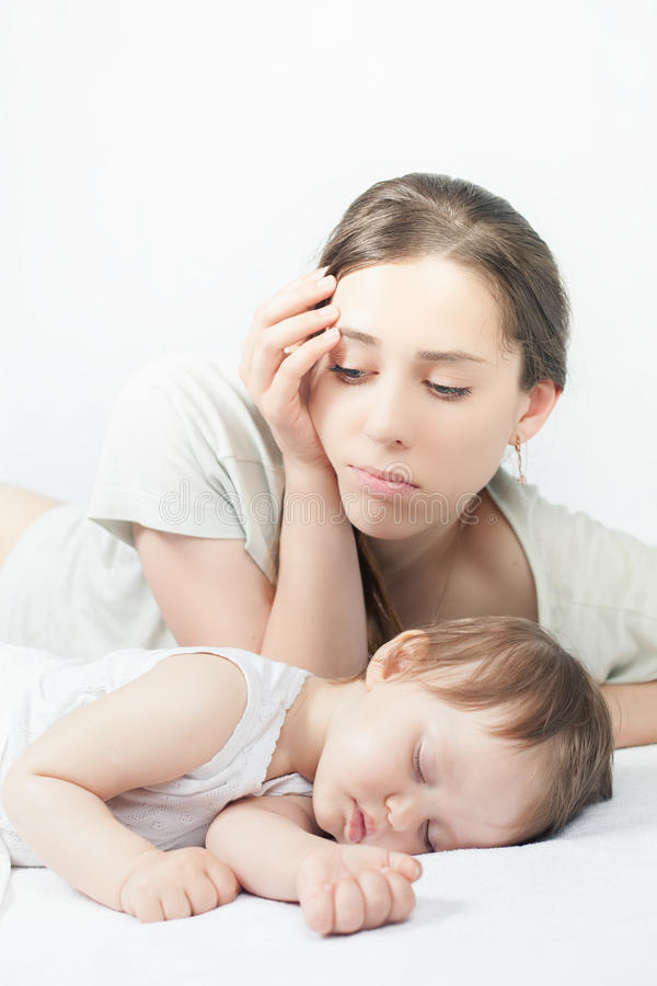 Sad mother with baby. Depressed woman, Sleeping child royalty free stock photography