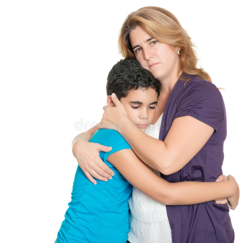 Sad mother hugging her son isolated on white royalty free stock photos