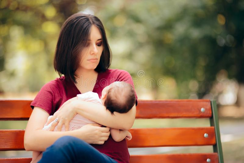 Sad Mother Suffering from Post Partum Depression Holding Baby stock photos