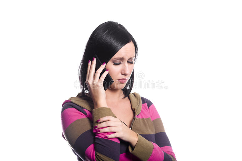 Sad news on the phone stock images