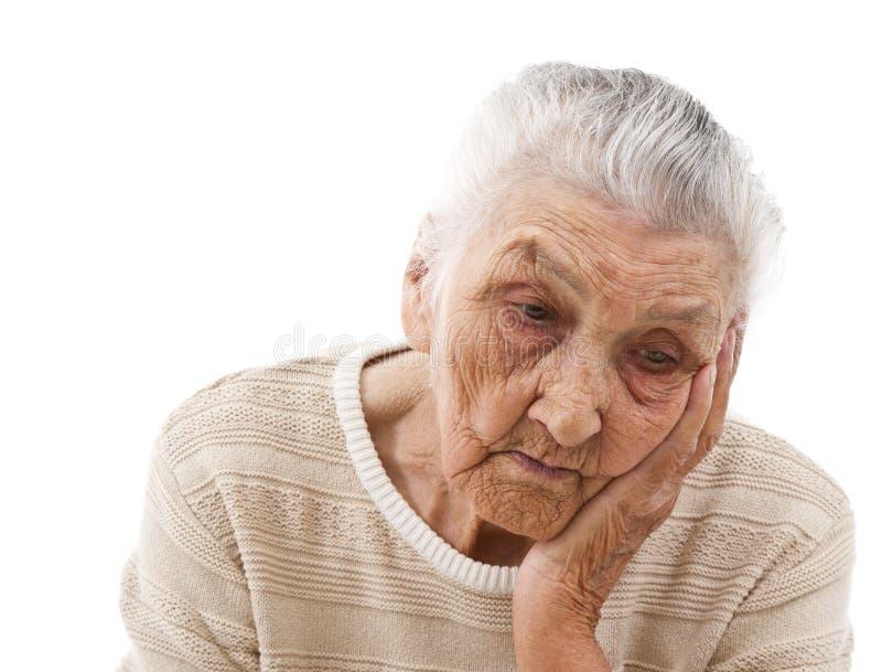 Sad old lady stock photography