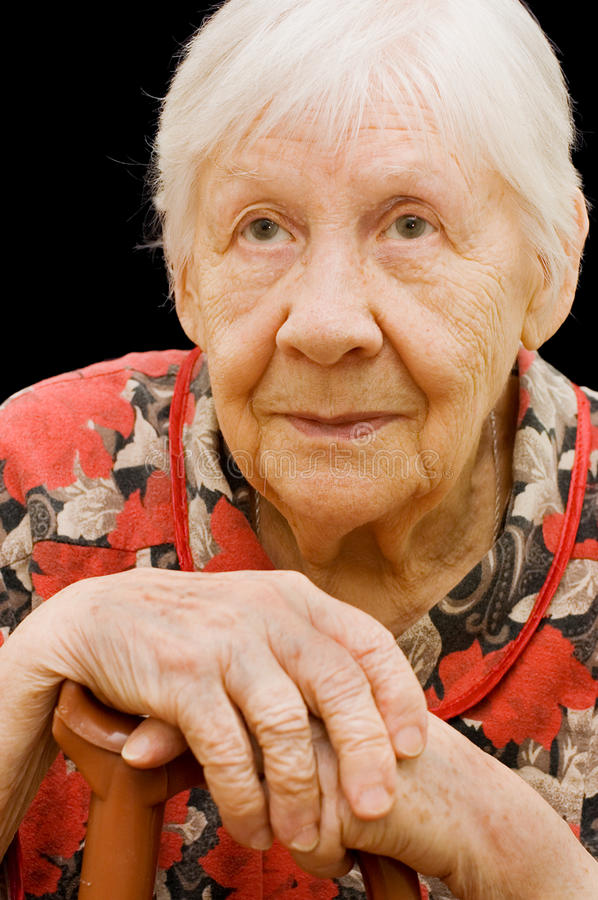 The sad old woman on the black. The sad old woman on black royalty free stock photos