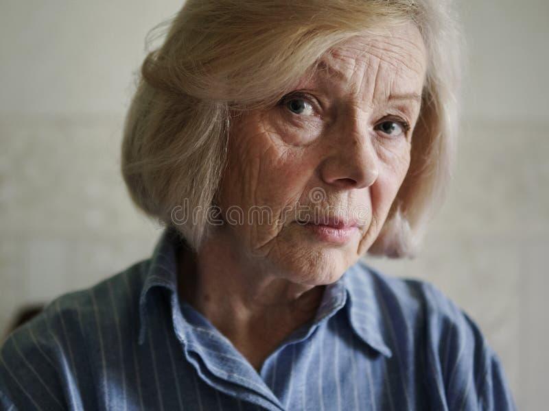 Sad old woman. Face of a sad old woman, close up stock images