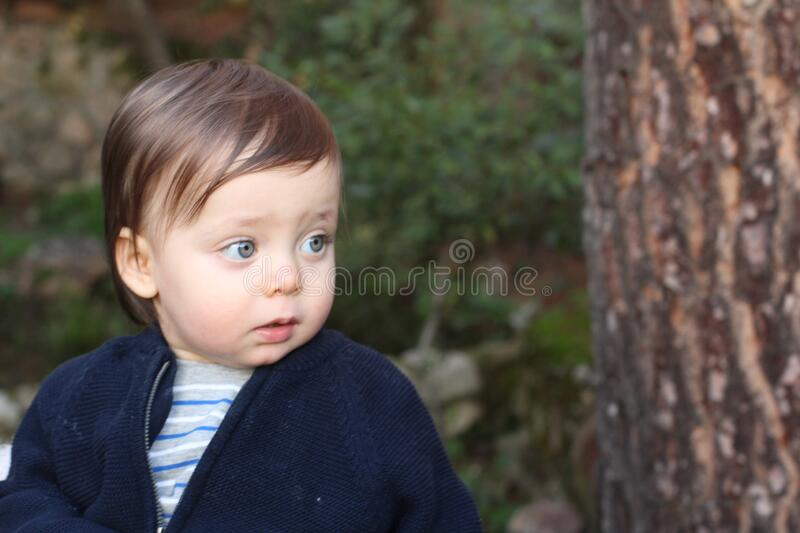 Sad one year old baby looking away royalty free stock images