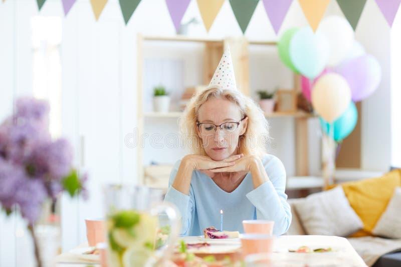 Sad woman celebrating birthday alone royalty free stock photography