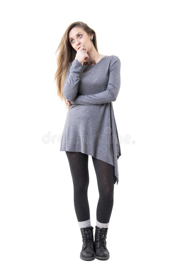 Sad pensive stylish young woman looking up thoughtfully. stock photography