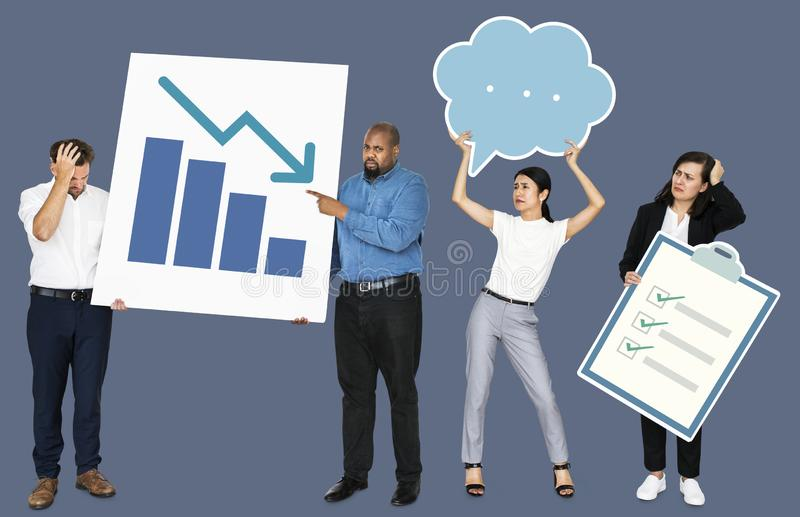 Sad people holding a bar chart and a checklist board stock photo
