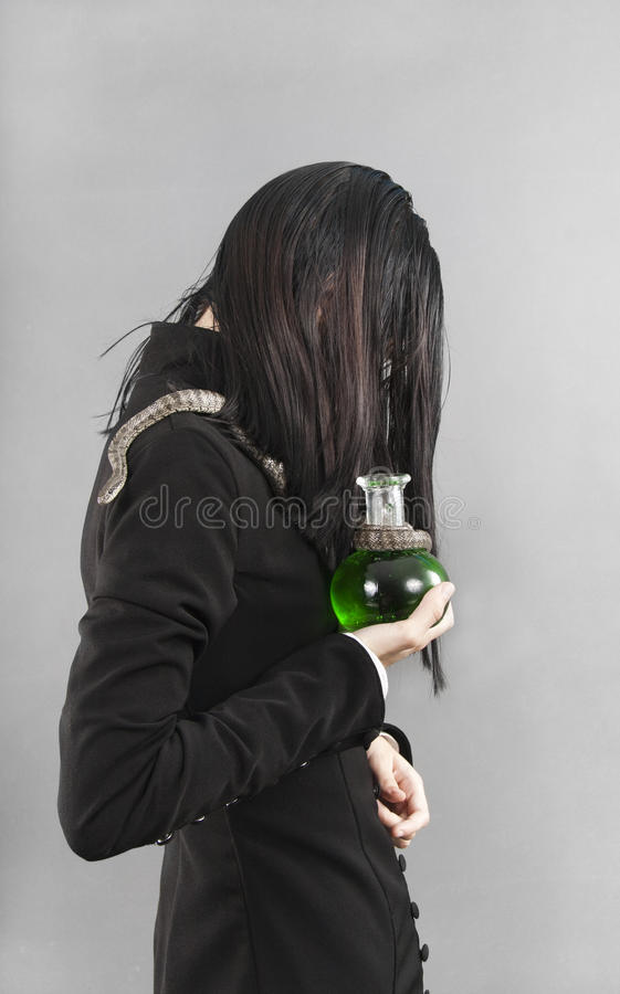 Download Sad Person With Snake Holding Poison Stock Photo - Image: 16078566