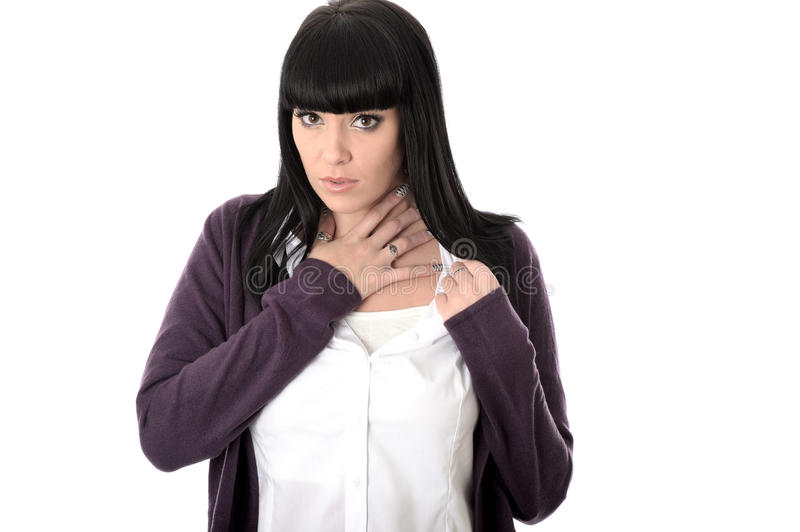 Sad Poorly Miserable Woman with Sore Throat. Or chest infection, with long straight black hair and hispanic or european features, looking at camera with unhappy royalty free stock photography