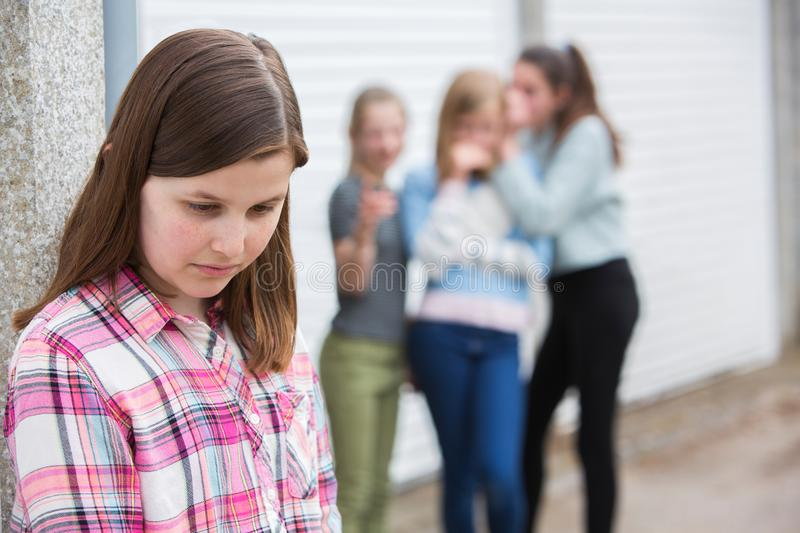 Sad Pre Teen Girl Feeling Left Out By Friends stock images