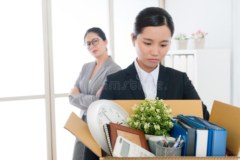 Sad pretty office worker girl losing company job stock image