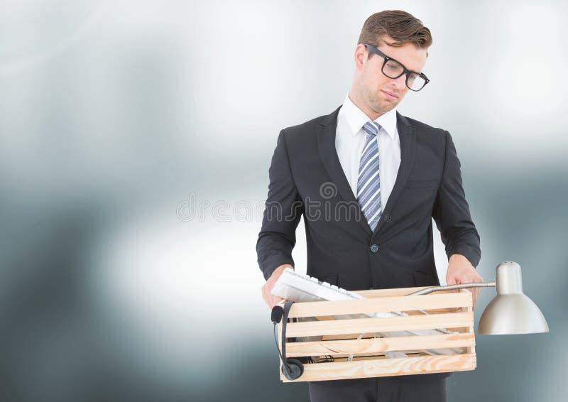 Sad redundant man job loss against blurred background. Digital composite of Sad redundant man job loss against blurred background royalty free stock photo