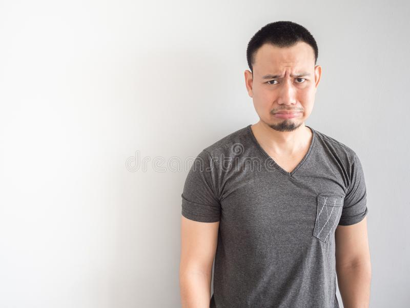 Sad and scared asian man in black t-shirt. royalty free stock photo