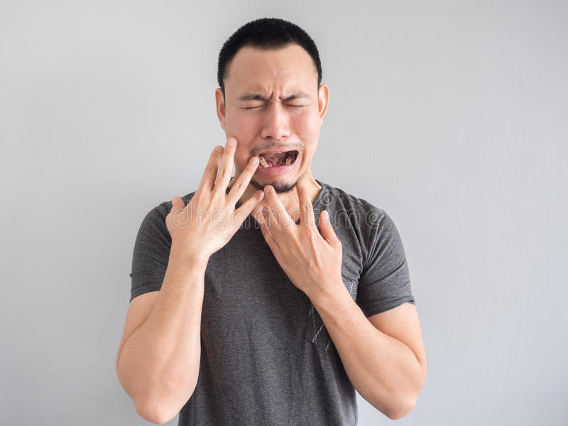 Sad and scared asian man in black t-shirt. royalty free stock photography