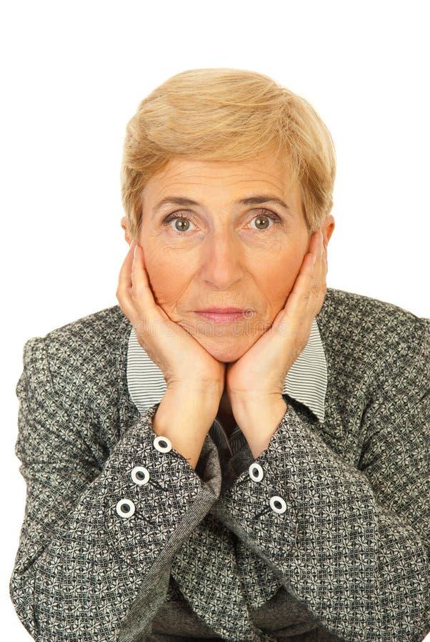 Sad senior business woman stock image