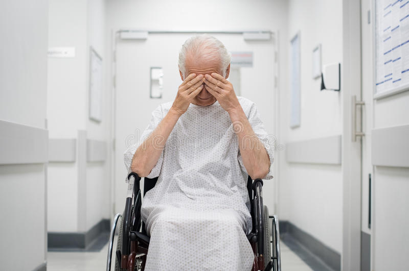 Sad senior man on wheelchair royalty free stock photography