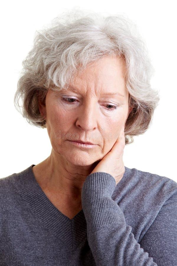 Sad senior woman crying stock photo