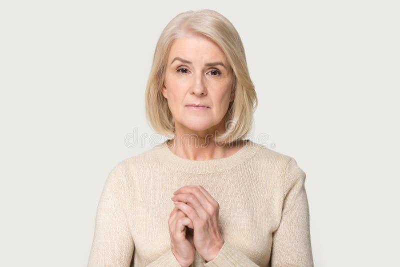 Sad senior woman isolated on grey background feel loneliness royalty free stock photos