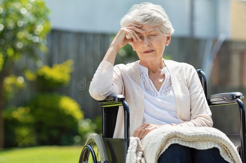 Depressed old woman in wheelchair royalty free stock photography