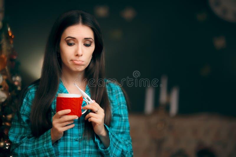 Sad Sick Girl with Thermometer on Christmas Holiday Drinking Tea stock photo