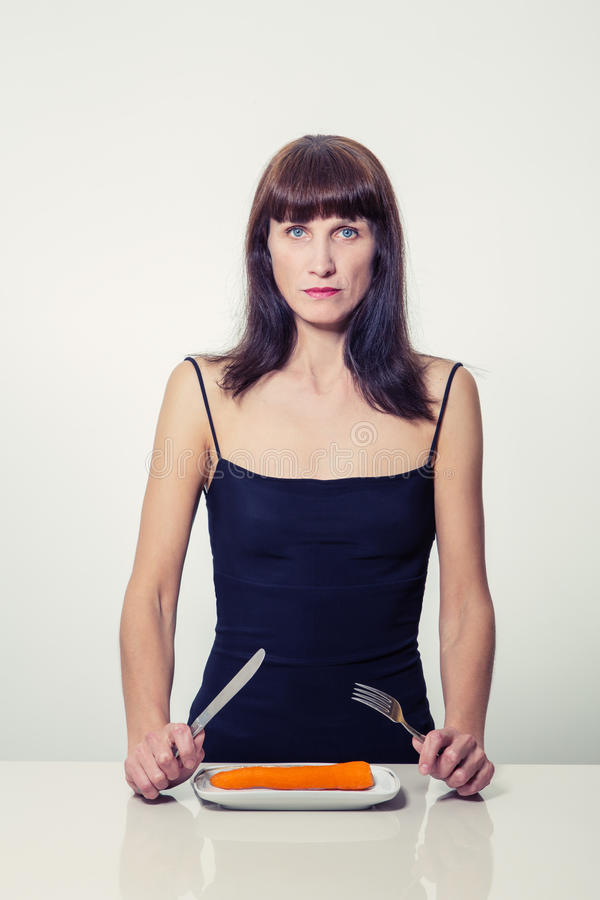Sad slim mature woman royalty free stock photography