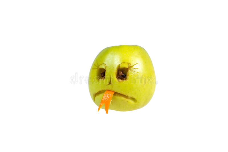 Sad smiley evil out of the apple. Feelings, attitudes. And emotions stock photos