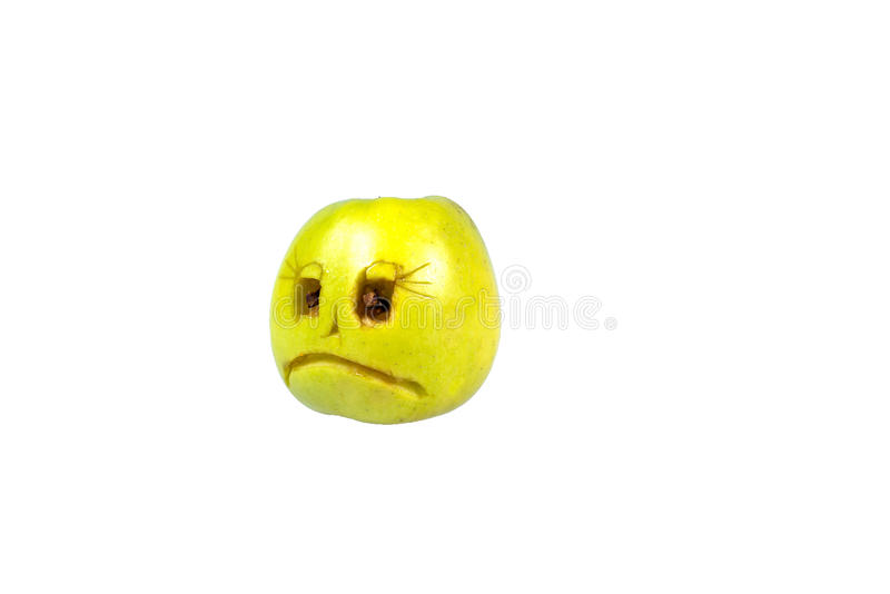 Sad smiley evil out of the apple. Feelings, attitudes. And emotions stock photography