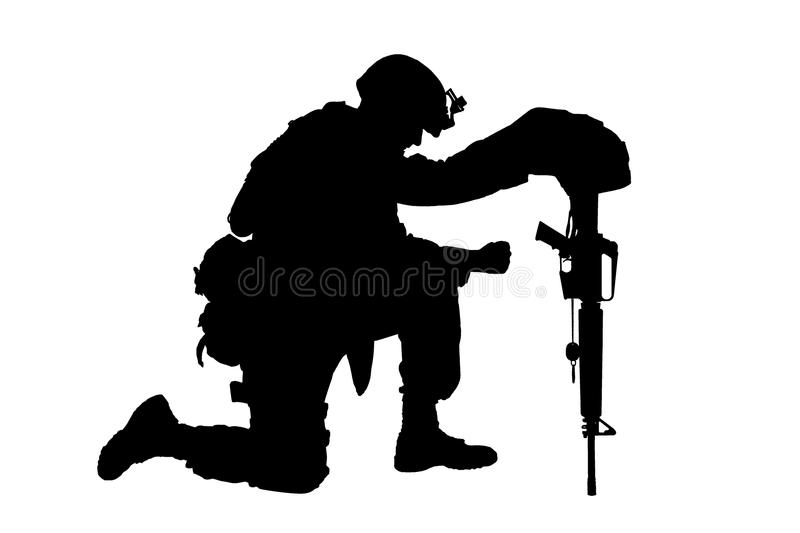 Sad soldier kneeling because of friend death royalty free stock images