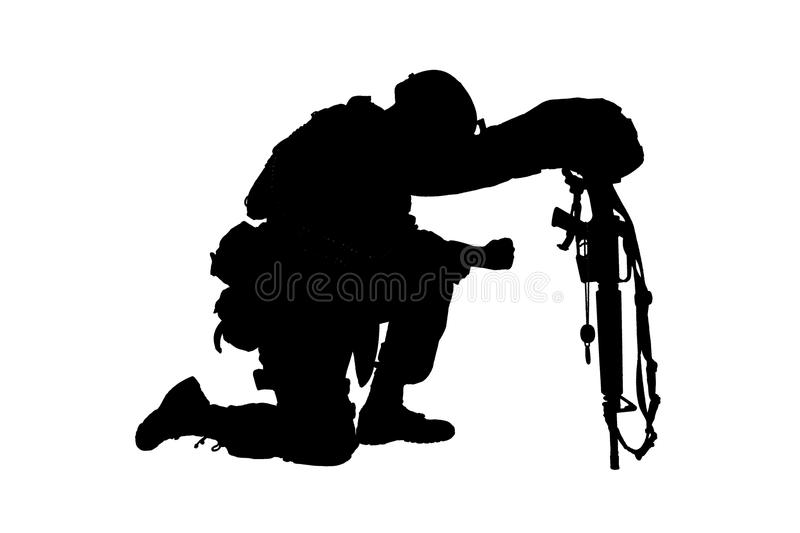 Sad soldier kneeling because of friend death royalty free stock photography