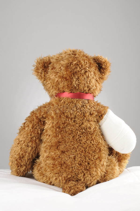 Sad teddy bear stock image