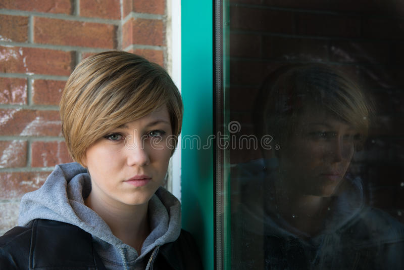 Sad teen girl stock photography