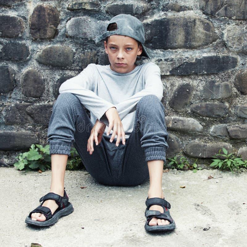 Sad teen outdoors royalty free stock image