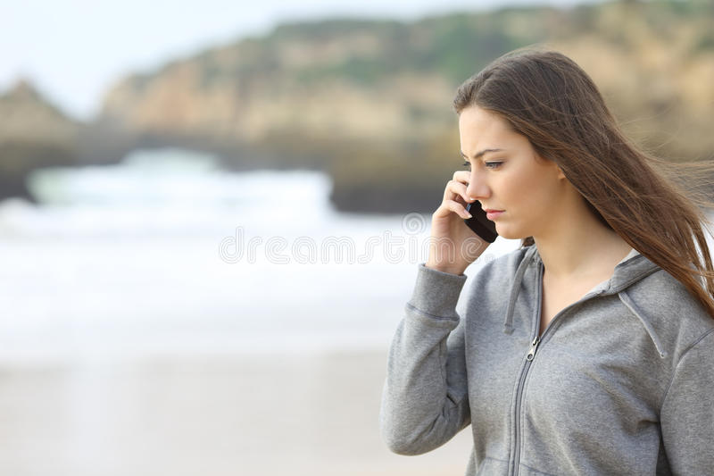 Sad teen talking on the phone royalty free stock photos
