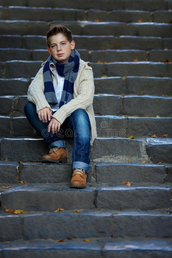 Free Sad Teenage Boy Sit On Stone Stairs Outdoor Stock Image - 27326711