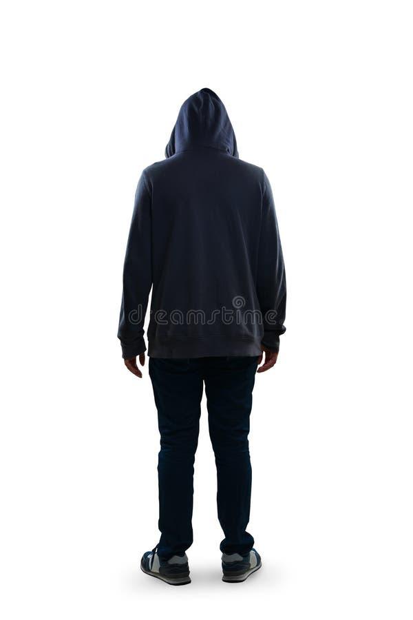 Sad teenage boy standing rear view stock photo