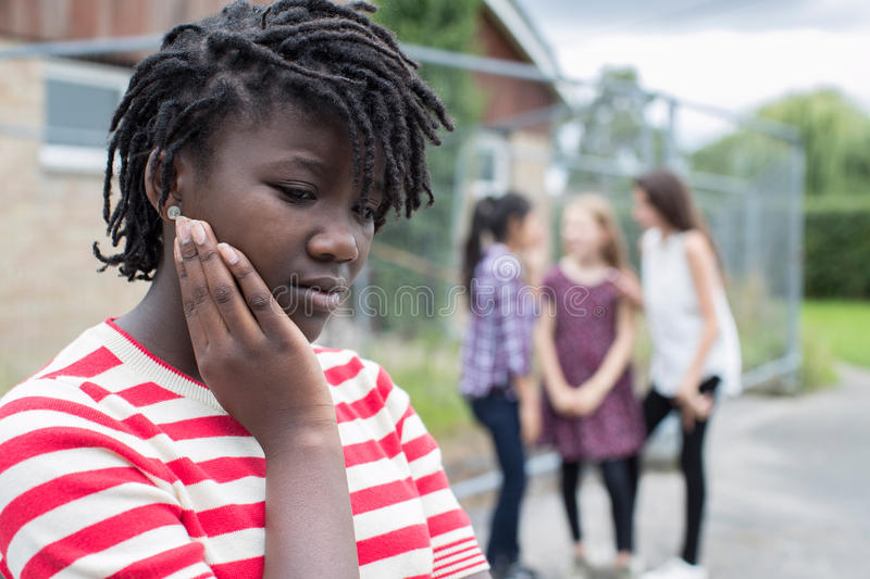 Sad Teenage Girl Feeling Left Out By Friends. Teenage Girl Feeling Left Out By Friends stock images