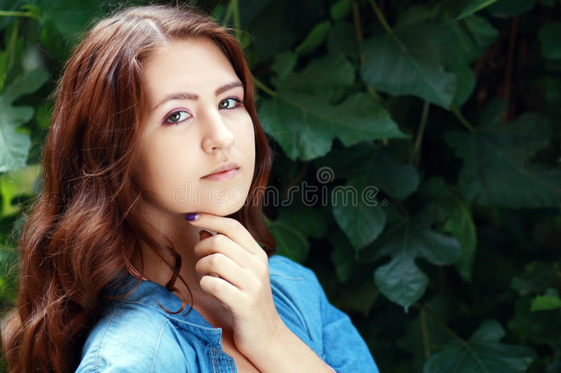 Sad teenage girl. Outdoor portrait of a sad teenage girl looking thoughtful about troubles royalty free stock image