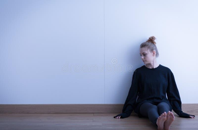 Sad teenage girl suffering. Picture of a sad teenage girl suffering from loneliness stock photos
